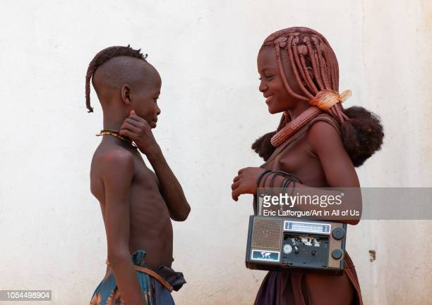 Himba tribe children with an audio tape recorder Cunene Province Oncocua Angola on August 16 2010 in Oncocua Angola