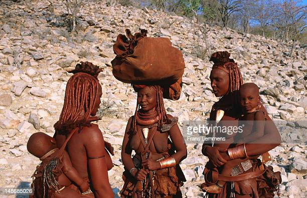 himba tribe mothers with babies. - opuwo tribe stock photos and pictures