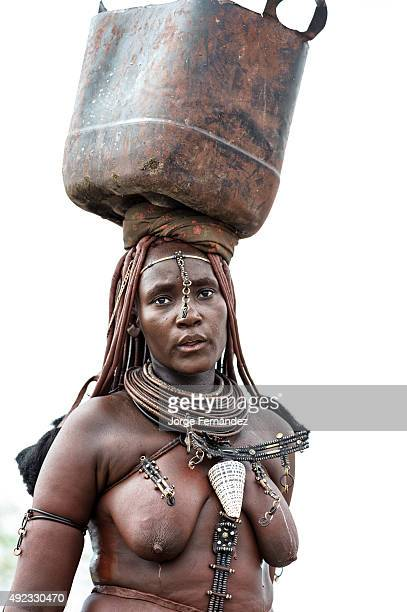 Himba woman carrying water on her head