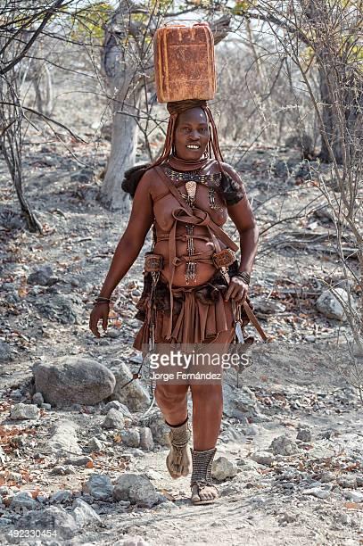 Himba woman collecting water