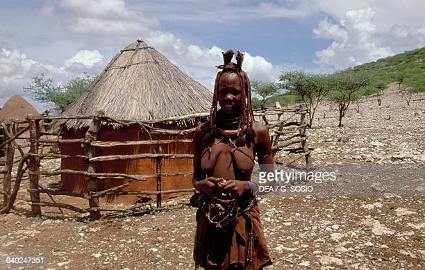 Himba woman in a village Damaraland Wilderness Area Namibia