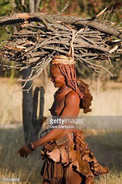 CONTENT] Himba woman in northern Namibia carrying firewood