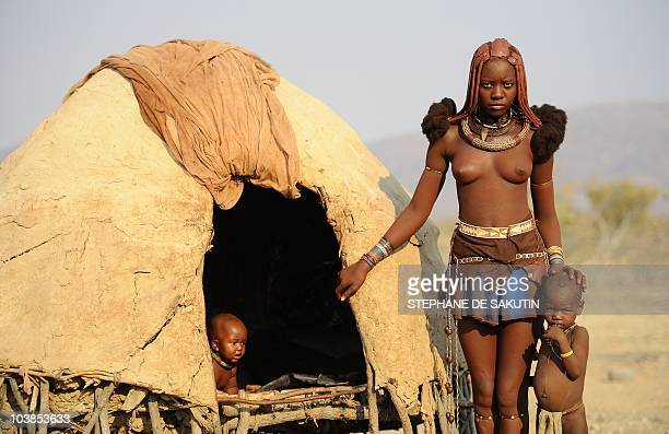 A Himba woman poses on August 19 2010 in the village of Otjakati 40 kms from Opuwo in northern Namibia AFP PHOTO / STEPHANE DE SAKUTIN