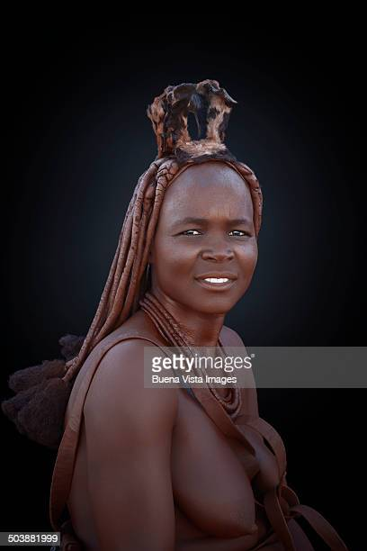 Himba woman with traditional hair dress