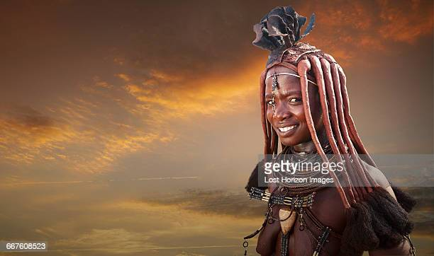 himba woman with traditional headpiece, namibia - himba foto e immagini stock