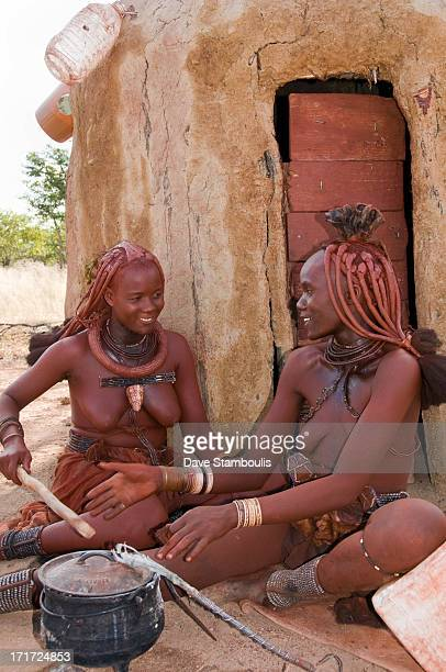 CONTENT] Himba women cooking in front of their hut in northern Namibia