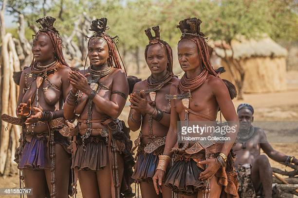 Himba Women Dancing And Clapping Hands At Their Village Near Opuwo. Namibia.