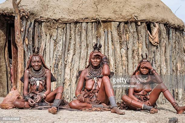 Himba women sitting on the floor