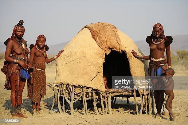Himba womwn pose on August 19 2010 in the village of Otjakati 40 kms from Opuwo in northern Namibia AFP PHOTO / STEPHANE DE SAKUTIN