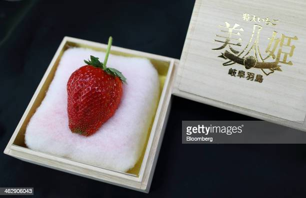 Himebijin strawberry, priced at 50,000 yen , sits in a wooden box at Okuda Farm in Hashima, Gifu Prefecture, Japan, on Tuesday, Jan. 14, 2013. The...