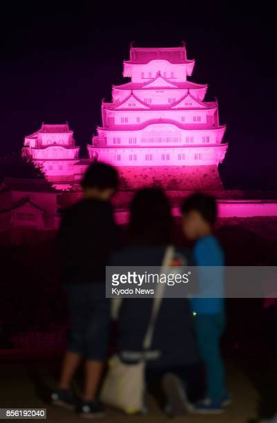 Himeji Castle a national treasure and World Heritage site in Himeji western Japan is lit up in pink on Oct 1 to mark the beginning of breast cancer...