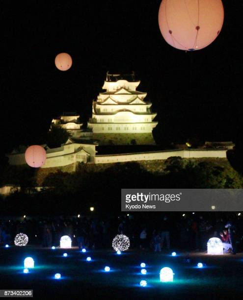 Himeji Castle a national treasure and World Heritage site in Himeji western Japan is lit up on Nov 10 2017 LED balloons were released from a square...