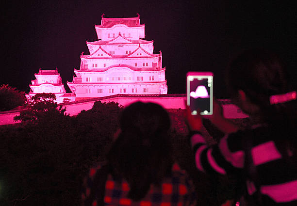 himeji castle is illuminated in pink on october 1 2016 in himeji hyogo