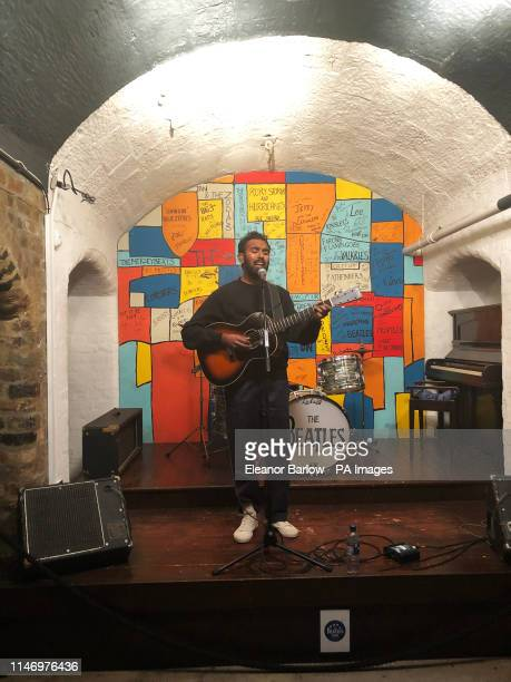Himesh Patel star of new Danny Boyle and Richard Curtis film Yesterday performing on stage in a replica of The Cavern at The Beatles Story in...