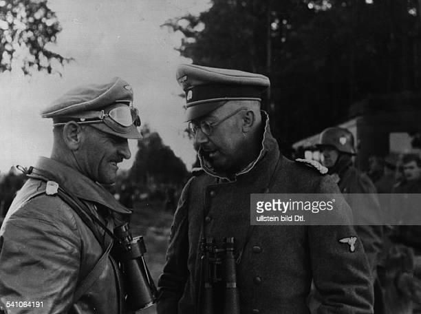 Himmler Heinrich * Politician Nazi Party GermanyHimmler talking to Joseph Dietrich commander of the SS 'Leibstandarte Adolf Hitler' in the rear area...