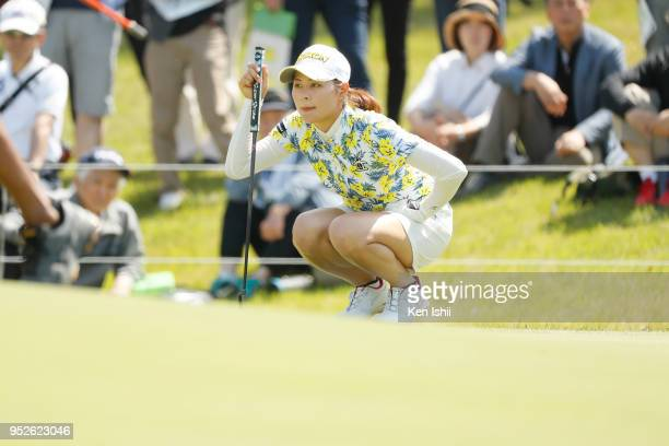 Hina Arakaki of Japan lines up for her putt on the first green during the final round of the CyberAgent Ladies Golf Tournament at Grand fields...