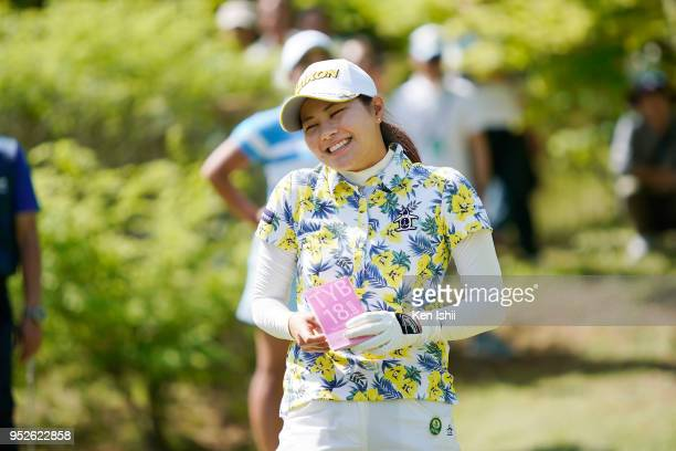Hina Arakaki of Japan smiles on the 17th hole during the final round of the CyberAgent Ladies Golf Tournament at Grand fields Country Club on April...