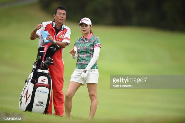 Hina Arakaki of Japan speaks with her caddie on the 18th hole during the second round of the Munsingwear Ladies Tokai Classic at Shin Minami Aichi...