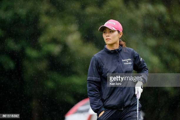 Hina Arakaki of Japan watches on the 18th hole during the final round of the Udonken Ladies at the Mannou Hills Country Club on October 15 2017 in...