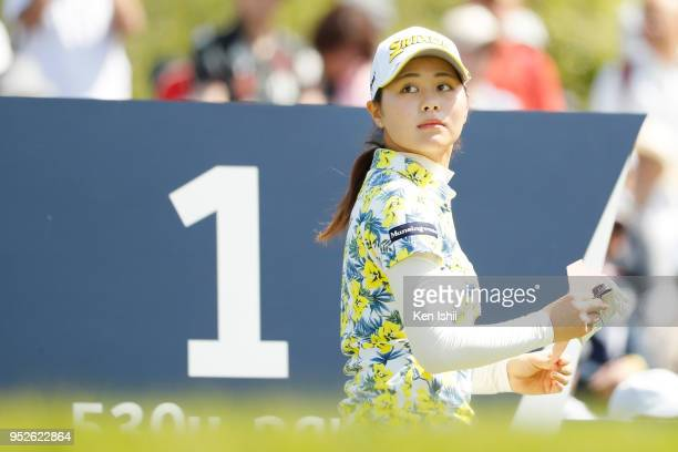 Hina Arakaki of Japan watches on the first hole during the final round of the CyberAgent Ladies Golf Tournament at Grand fields Country Club on April...
