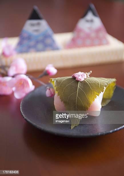 Hina dolls and sakura mochi (cherry flavored soft sweet rice cake)