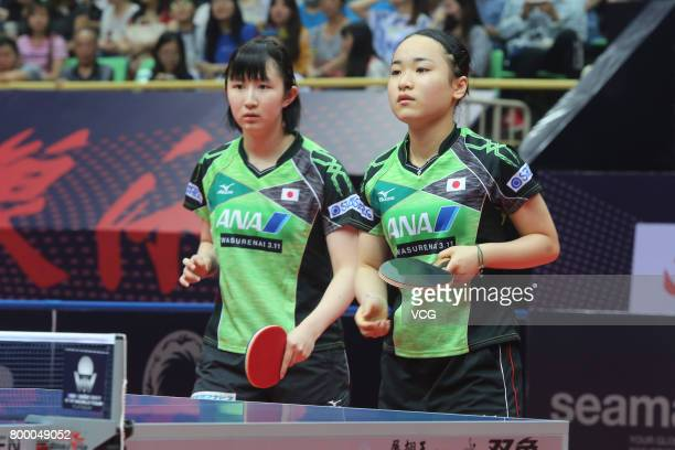 Hina Hayata and Mima Ito of Japan compete during the women's doubles first round match against Choi Hyojoo and Jung Yumi of Korea on the day one of...