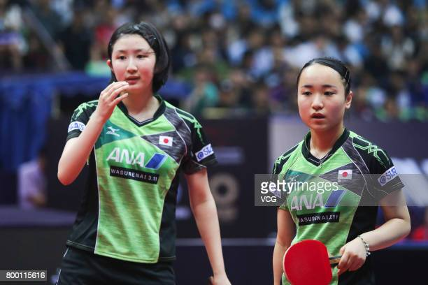 Hina Hayata and Mima Ito of Japan compete during the women's doubles quarterfinal match against Zhu Yuling and Chen Meng of China on the day two of...
