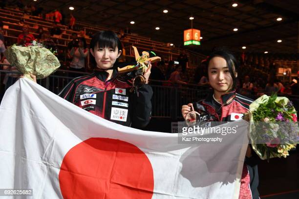 Hina Hayata and Mima Ito of Japan won the bronze medal for the first time after 48 years hold Japanese flag during the Table Tennis World...