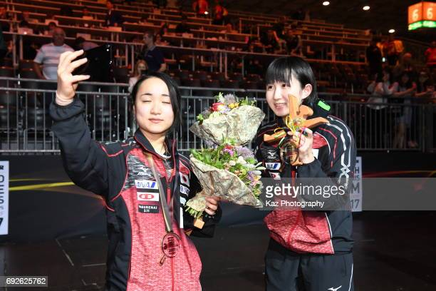 Hina Hayata and Mima Ito of Japan won the bronze medal for the first time after 48 years and take the picture by themselves during the Table Tennis...