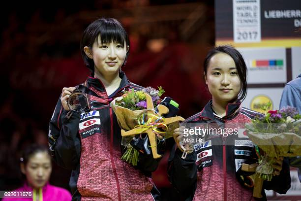 Hina Hayata of Japan and Mima Ito of Japan pose with a bronze medal during the celebration ceremony of Women's Doubles at Table Tennis World...