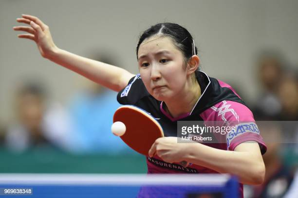 Hina Hayata of Japan competes against Yihan Zhou of Singapore during the women's singles round one match on day one of the ITTF World Tour LION Japan...