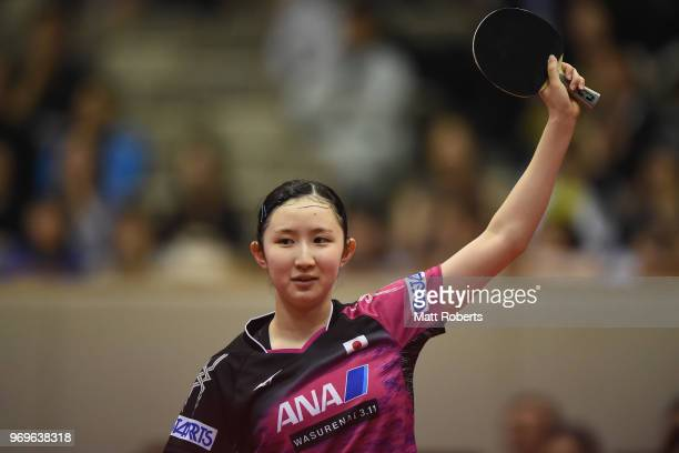 Hina Hayata of Japan reacts against Yihan Zhou of Singapore during the women's singles round one match on day one of the ITTF World Tour LION Japan...