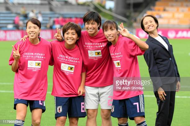 Hina Sugita, Mana Iwabuchi, Rei Takenaka, Emi Nakajima and head coach Asako Takakura of Japan pose for photographs after their 4-0 victory in the...