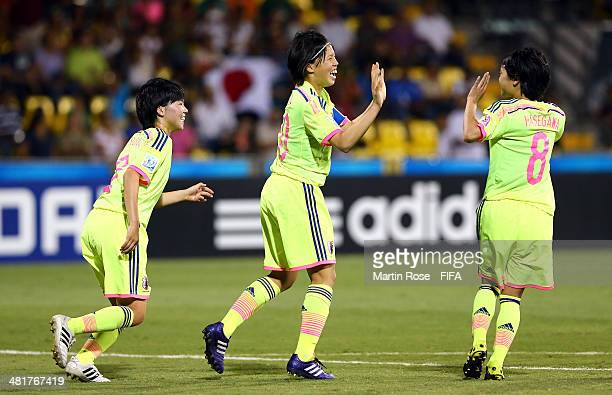 Hina Sugita of Japan celebrates after scoring the 4th goal during the FIFA U17 Women's World Cup 2014 semi final match between Venezuela and Japan at...
