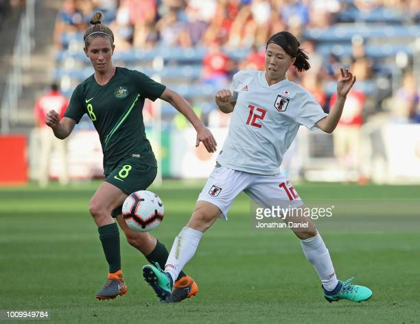 Hina Sugita of Japan passes around Elise KellondKnight of Australia during the 2018 Tournament Of Nations at Toyota Park on August 2 2018 in...