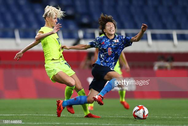 Hina Sugita of Team Japan is challenged by Sofia Jakobsson of Team Sweden during the Women's Quarter Final match between Sweden and Japan on day...
