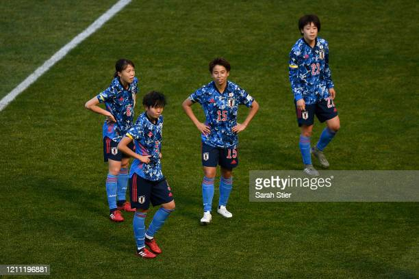 Hina Sugita, Shiori Miyake, Mina Tanaka, and Mayo Doko of Japan look on during the first half against England in the SheBelieves Cup at Red Bull...