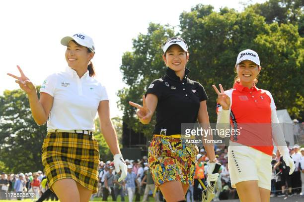 Hinako Shibuno, Erika Hara and Hina Arakaki of Japan pose for photographers after their tee shot on the 1st hole during the first round of the...