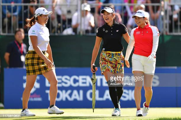 Hinako Shibuno, Erika Hara and Hina Arakaki of Japan share a laugh after their tee shots on the 1st hole during the first round of the Descente...