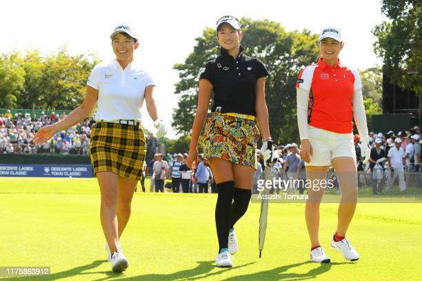 Hinako Shibuno, Erika Hara and Hina Arakaki of Japan walk after their tee shots on the 1st hole during the first round of the Descente Ladies Tokai...
