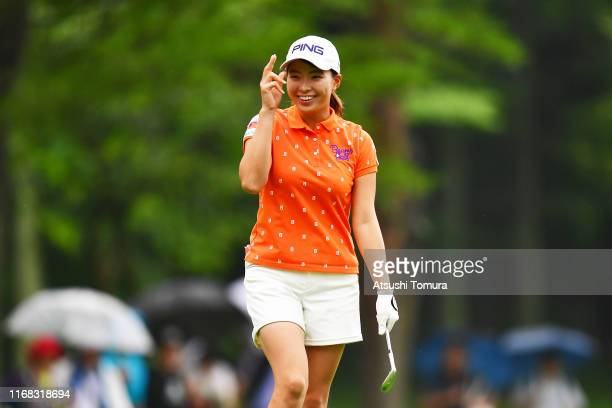 Hinako Shibuno of Japan acknowledges fans after making a chipin birdie on the 1st green during the first round of Karuizawa 72 Golf Tournament at...