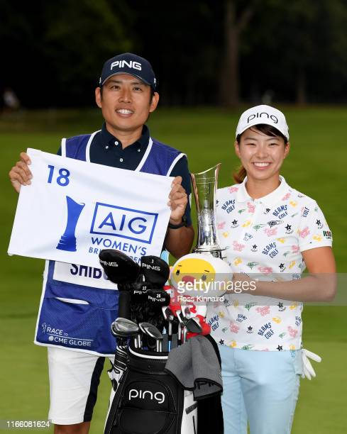 Hinako Shibuno of Japan and her caddie celebrate after the final round of the AIG Women's British Open at Woburn Golf Club on August 04, 2019 in...