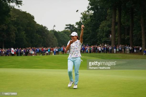 Hinako Shibuno of Japan celebrates as she holes the winning putt on the 18th green during Day Four of the AIG Women's British Open at Woburn Golf...