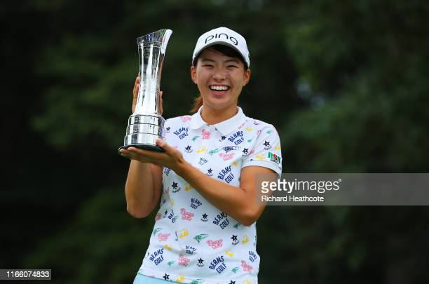 Hinako Shibuno of Japan celebrates victory with the trophy during Day Four of the AIG Women's British Open at Woburn Golf Club on August 04, 2019 in...