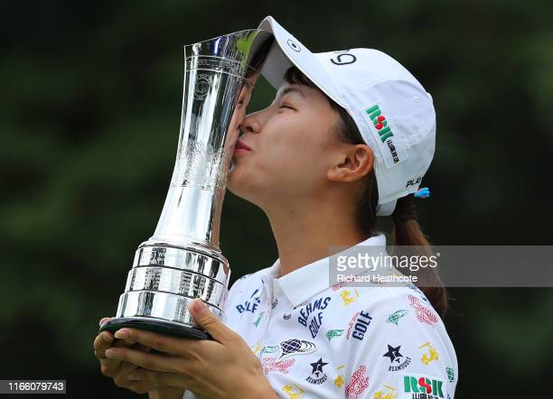 Hinako Shibuno of Japan celebrates victory with the trophy during Day Four of the AIG Women's British Open at Woburn Golf Club on August 04 2019 in...