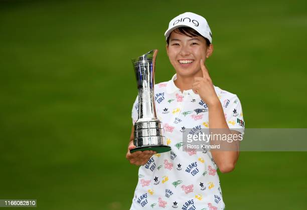 Hinako Shibuno of Japan celebrates with the trophy after the final round of the AIG Women's British Open at Woburn Golf Club on August 04 2019 in...