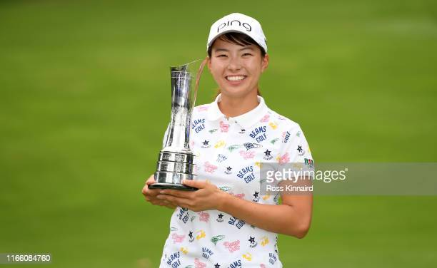 Hinako Shibuno of Japan celebrates with the trophy after the final round of the AIG Women's British Open at Woburn Golf Club on August 04, 2019 in...