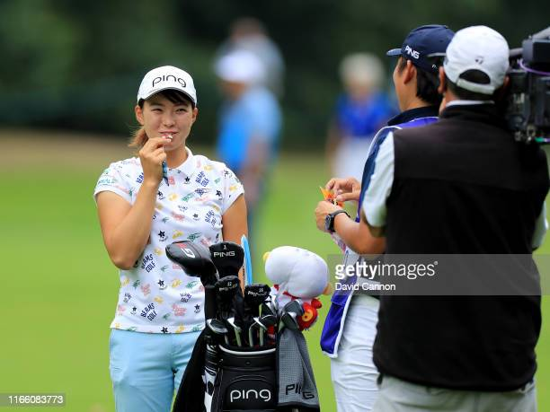 Hinako Shibuno of Japan eats a snack before she played her second shot on the par 4, 16th hole during the final round of the AIG Women's British Open...