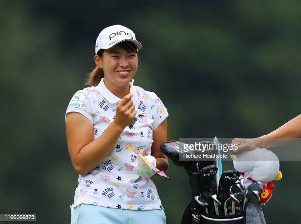Hinako Shibuno of Japan enjoys a snack on the 16th fairway during Day Four of the AIG Women's British Open at Woburn Golf Club on August 04 2019 in...