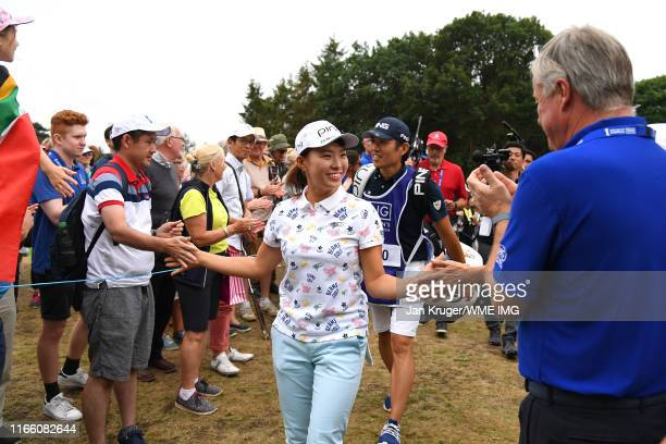 Hinako Shibuno of Japan high five fans during Day Four of the AIG Women's British Open at Woburn Golf Club on August 04 2019 in Woburn England